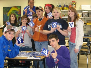 Middle School students show off coasters made for Harbor sale